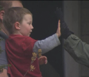 SWAT Member High-Fiving Young Boy During The Boston Bomber Manhunt