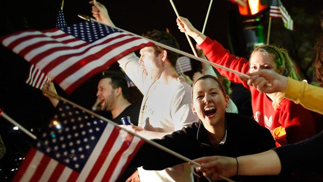 People wave U.S. flags